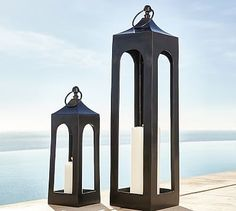 """These tall lanterns are amazing. they are 8"""" wide and 36"""" tall. Would look really cool in the front hall niches!  Caleb Lanterns - Black #potterybarn"""