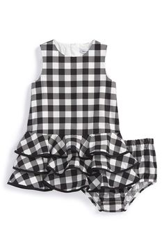 Free shipping and returns on Dolce&Gabbana Gingham Sleeveless Dress & Bloomers (Baby Girls) at Nordstrom.com. Pretty up her look with this lightweight, sleeveless dress trimmed in tiers of floaty ruffles and flared at the dropped waist for a delightfully girly finish. Matching bloomers complete the on-trend-for-spring look.