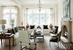 """As a designer, I don't want any room to feel too precious,"" interior designer Barbara Westbrook says. ""Today, people want to live in every room of the house."" In the living room, seating groups (a mix of custom, Bungalow Classic and B.D. Jeffries pieces) encourage lingering conversation and inviting warmth when family and friends gather."