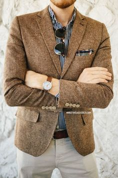 Wear a brown wool blazer jacket with nude chinos if you're going for a neat, stylish look.   Shop this look on Lookastic: https://lookastic.com/men/looks/blazer-long-sleeve-shirt-chinos/17009   — Navy and White Gingham Long Sleeve Shirt  — Dark Green Pocket Square  — Brown Wool Blazer  — Dark Brown Leather Belt  — Beige Chinos
