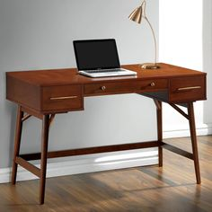 Enjoy comfortable computing and working from home, with this mid-century modern style writing/ computer desk. Finished in a beautiful walnut color with bronze hardware. Angled round and tapered legs give this desk a simple mid-century modern appeal.