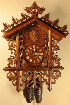 Deep Case Bahnhausle Cuckoo Clock, Model #8223       Exquisitely carved bahnhausle cuckoo clock. German 8 Day Regula movement with gong and cuckoo on the hour and half-hour. Deep carved with wooden dial, numbers, hands and cuckoo bird. Antique stain, night shut-off and 2 year warranty. Made by Romba & Haas.