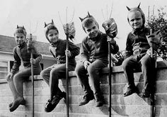 four devils on a wall