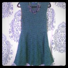 Green Lace Dress (L) This green lace dress has short sleeves and textured fabric. The lace is see through in the back up to the waist (pictured). It's fully lined everywhere else and has a super flattering fit!   Make me an offer! Blue S Dresses Mini