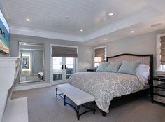 "Bedroom. Beautiful master bedroom with gray walls (Benjamin Moore Moon Shadow) and carpet flooring. Carpet is Tuftex : ""Silver Mist"". Patterson Custom Homes"