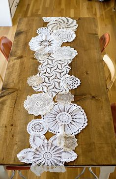 Sew doilies together to make a table runner Sarah, this across the burlap on a table would be pretty!