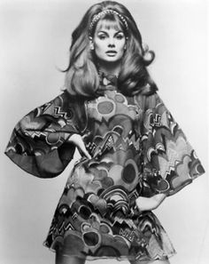 So 60s - hair and love the dress.