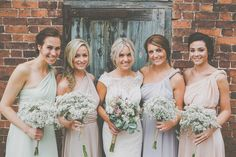 Mis-match Multi-way Pastel Bridesmaid Dresses   Gypsophila Bouquets   JLM Couture Alvina Valenta Lace Wedding Dress   DIY Rustic Wedding at Shustoke Farm Barns in Warwickshire   Images by James Melia   http://www.rockmywedding.co.uk/jo-lee/