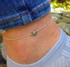 Tiny dainty silver sea turtle ankle bracelet on by Serenityproject