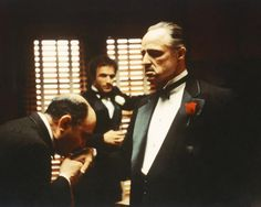 "The Godfather: From left to right, Salvatore Corsitto as Bonasera, James Caan as Santino 'Sonny' Corleone and Marlon Brando as Don Vito Corleone in ""The Godfather,"" 1972. Bonasera asks Don Corleone to avenge the brutal rape of his daughter. (Photo by Silver Screen Collection/Hulton Archive/Getty Images)"