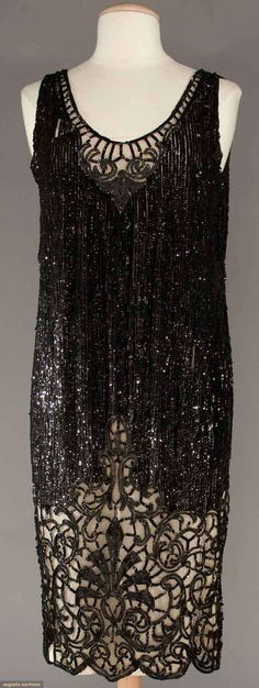 Black net covered in sequins, neckline & deep hem band worked in black bugle beads in Deco pattern, B to H to L (some sequin loss) very good. 20s Fashion, Art Deco Fashion, Fashion History, Vintage Fashion, Clothing And Textile, Antique Clothing, Vintage Dresses, Vintage Outfits, 20th Century Fashion
