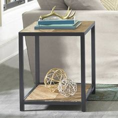 Handcrafted to fulfill our quest for an authentic-looking urban industrial table design that has a modern rustic edge, our exclusive Porter Coffee Table is    a solid find. It built of metal and mindi wood (also known as white cedar), arranged in a herringbone pattern for clean, simple lines. Use it in a    living room, den, or sunroom. This is a functional accent piece your guests will probably ask you about, leaving you with a choice: create a tale about a    fictitious bearded furnitur...
