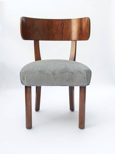 Four Swedish Art Deco Dining Chairs by Axel Einar Hjorth for NK Stockholm | From a unique collection of antique and modern dining room chairs at https://www.1stdibs.com/furniture/seating/dining-room-chairs/