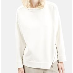 """NEWTopshop Zipper Long Sleeve Shirt Size: 8 Color: White Measurements: 22.6"""" Fabric: Polyester, Viscose Year bought: 2016 Condition: New with Tags                                      Pic#2 and 4 are the actual top. The other two are similar on a model. Topshop Tops Sweatshirts & Hoodies"""