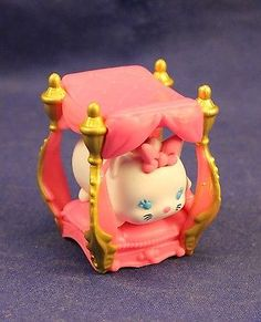 Here is cute little Marie from the movie Aristocats, and she has a little fancy bed. I want it.