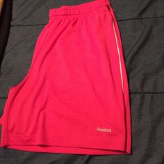 Pink reebok bball shorts Never worn. In great condition Reebok Shorts