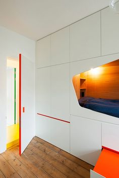 Design details of a wall of cabinets with a sleeping nook for a child's bedroom by Van Staeyen Interieur Architecten