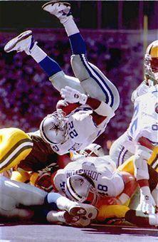 8) fall back - Emmitt Smith, Dallas Cowboys, falls back to terra firma....