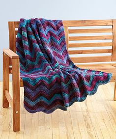 Try this crochet throw in Tweed Stripes for a beautiful throw to have during the summer when all you can think of is the beach.