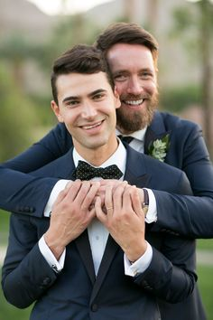 Dapper grooms in navy blue: Photography : Michael Segal Photography Read More on SMP: http://www.stylemepretty.com/california-weddings/rancho-mirage-california/2016/06/08/this-same-sex-wedding-sets-the-record-for-chicness/