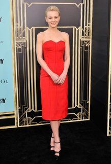 'The Great Gatsby (2013)   NYC Premiere: Carey Mulligan (Daisy Buchanan) on the arrival carpet wearing red Lanvin and jewels by Tiffany & Co.