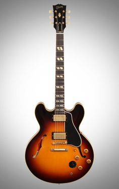 Gibson 1959 ES-345TD Electric Guitar: Torch the fretboard on the ES-345TD. Its 'Mickey Mouse' double cutaway means high-neck access for incendiary solos, while MHS humbuckers provide beefy tone.