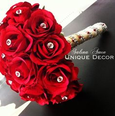 Beautiful red rose wedding bouquet with golden handle detail. Perfect for a desi wedding.