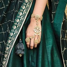 The quintessential hathphool, a piece of traditional bridal jewellery that symbolises the bonds of marriage. Pictured here is our Silver Hathphool. Indian Jewelry Sets, Silver Jewellery Indian, India Jewelry, Silver Jewelry, Silver Rings, Silver Anklets, Antique Jewellery, Diamond Jewellery, Ethnic Jewelry