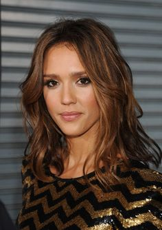 love the warm overall brunette color with the golden highlights to frame the face