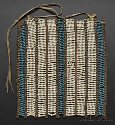 Rare Ute Beaded Breastplate | c. last third 19th century | With multiple rows of white and blue glass beads strung between commercial leather spacers decorated with brass tacks, traces of red pigment, 11 1/2 x 10 1/2 in. | 4500$ ~ Sold