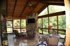 Porch with a fireplace and tv   ... Screened porch with tile floor & corner fireplace with a TV!   Yelp