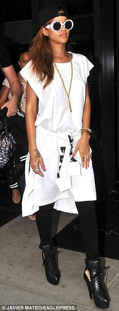 Rihanna struts the streets on NYC in Roman-inspired outfit and medallion | Mail Online