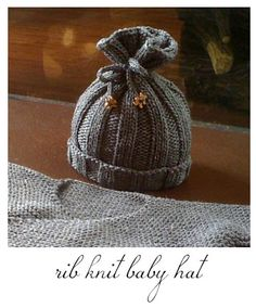 Knit baby hat!  Cute idea, with enough stretch worked in this could be made long enough for multiple ages.