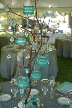 like the little glass holders with fake candles to bring in the teal if I do branch centerpieces