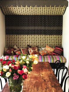 moroccan-inspired bench seating with multi-colored jewel-toned