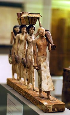 Ancient Egypt and Archaeology Web Site - Painted wood offering bearers from the tomb of Djehuty-Nakht at Deir el-Bersha dating to the late Dynasty Ancient Egypt Art, Old Egypt, Ancient Artifacts, Ancient History, Kemet Egypt, Empire Romain, Art Ancien, Ancient Civilizations, Egyptians