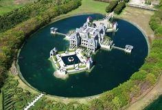 Charles Sieger's Redlands Island Castle Relisted For $10.9M - On The Market - Curbed Miami ... crazy....a moat? or would you call this an island?