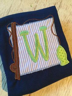 A personal favorite from my Etsy shop https://www.etsy.com/listing/269200477/boys-fishing-pole-patch-monogram