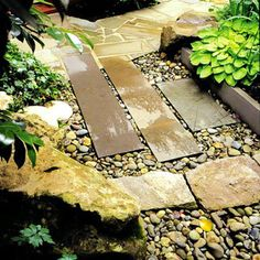 Large, rectangular pavers are set into river rock, concealing a French drain. (A French drain is a shallow trench that collects surface water and directs it… Diy Garden, Shade Garden, Garden Projects, Garden Paths, Asian Garden, Flagstone Path, Stone Walkway, Rock Walkway, Rock Path