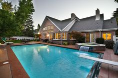 This luxurious Salt Lake City estate's backyard is the epitome of grandiose outdoor space.