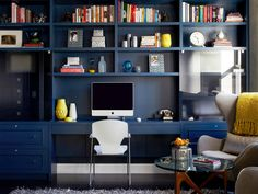 HGTV Shop the Look: Bold, Blue Office >> http://photos.hgtv.com/rooms/viewer/living-space/home-office/contemporary-home-office-with-navy-bookshelves-and-yellow-accents?soc=pinterest
