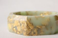mint gold octagonal eco resin faceted bangle with metallic gold flakes. $175.00, via Etsy.
