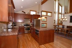 Best Kitchen Design for U-shaped Kitchens: Amusing Best Kitchen Designs U Shaped Plans Remodelling Ideas With Full Of Wooden Cabinets And Laminate Flooring Decoration Also White Sloping Ceiling ~ workdon.com Kitchen Design Inspiration