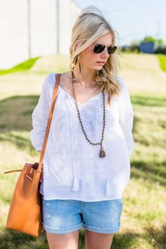 Pair a simple billowy blouse with a leather bag for a casual boho look that is perfect for summer.