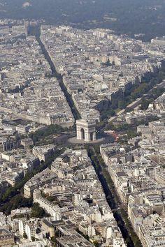 An aerial view shows the Arc de Triomphe and rooftops of residential buildings in Parisin Paris. Paris Vu Du Ciel, Belle France, Triomphe, Paris City, Best Sites, Tour Eiffel, Paris Jackson, France Travel, Aerial View