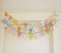 Fabric Bunting, I would like to DIY one of these for Wickerbean's nursery to hang over her crib.