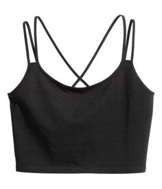 Black. Short top in cotton jersey with narrow, double shoulder straps crossed at back.