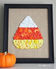 Candy Corn Button Art | DIY Burlap Fabric Ideas Will Offer Your Home A Rustic Country Look by Pioneer Settler at http://pioneersettler.com/burlap-fabric-to-decorate-your-home-this-fall/