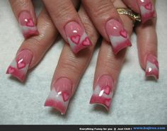 beautiful pink and white French tips with fimo hearts very cute for valentines day.