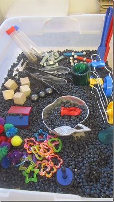 Cool Magnet Sensory Bin - using black beans as a base, add a variety of magnetic and non magnetic items (wood, plastic, fabric, metal, glass and aluminum) and let the kids have at it!